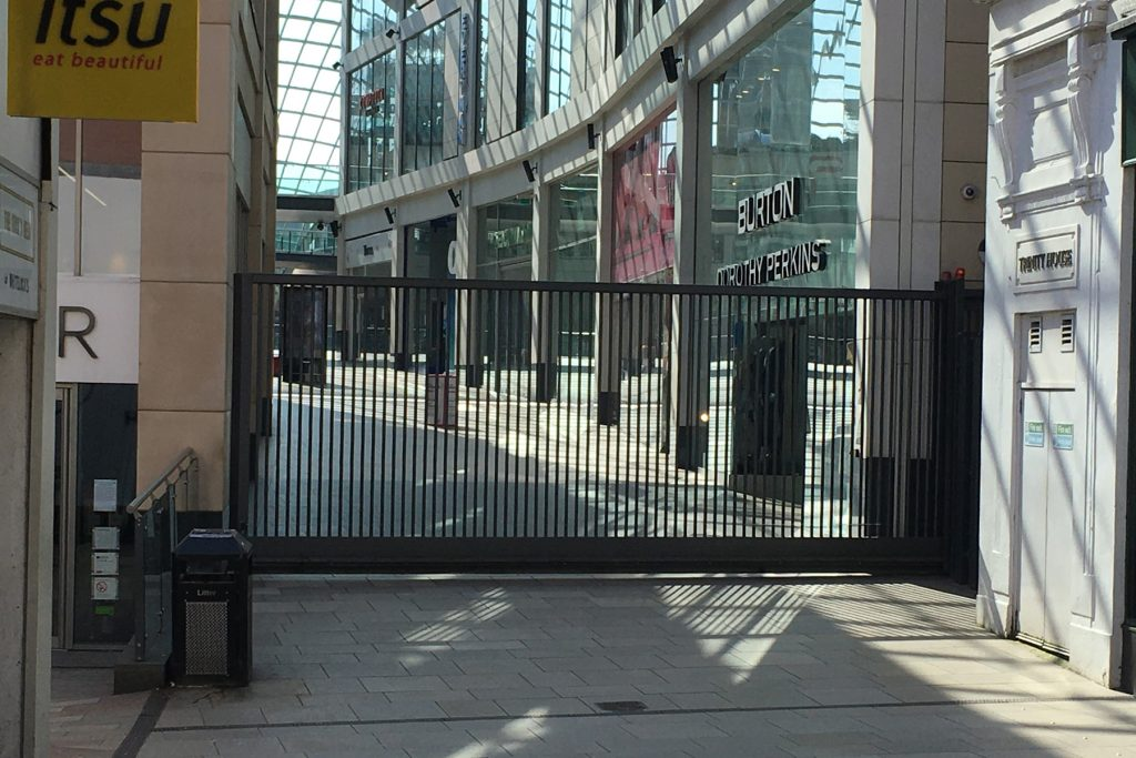 Photo: metal gate across the entrance to Trinity Leeds / Trinity Square from Lands Lane.